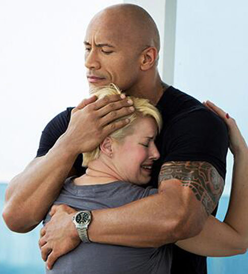 Patty from The Hero embraces The Rock
