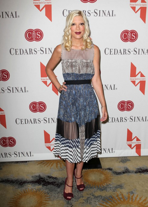 Tori Spelling attends The Helping Hand of Los Angeles presents the 84th Annual Mother's Day Luncheon and Fashion Show featuring Kevan Hall designs at The Beverly Hills Hotel in Los Angeles, California, United States.