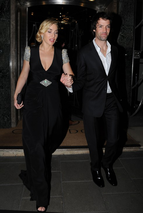 Kate Winslet with with boyfriend Ned Rocknroll, leaves Claridge's Hotel wearing a glistening Jenny Packham black gown in London, England.