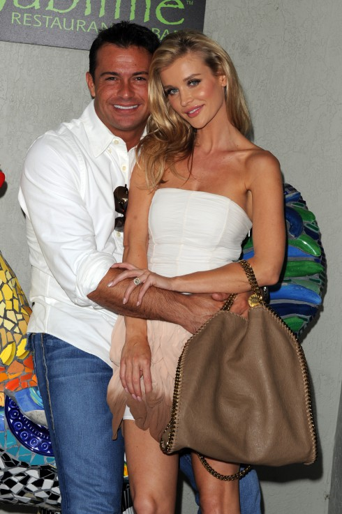 "Joanna Krupa and Romain Zago unveil the ""Be an Angel for Animals"" ad campaign for PETA at Sublime Restaurant and Bar in Ft Lauderdale, Florida."