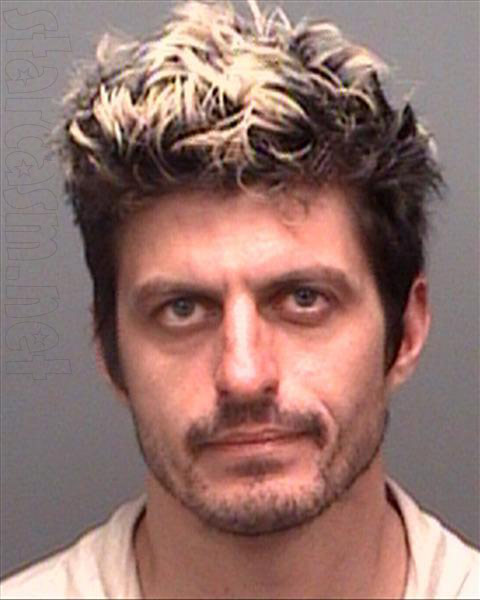 Doomsday Castle Brent Bruns mugshot 2009 with blonde highlights in his hair