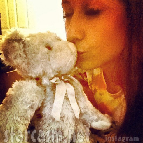 Nikkole Paulun and the teddy bear containing her dead baby Ashton's cremated ashes