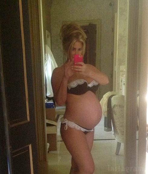 Kim Zolciak pregnant with twins in a lingerie bikini