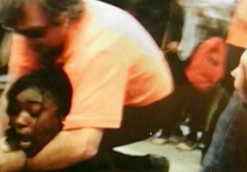 Principal seen allegedly choking student to break up fight