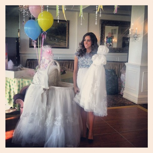 Pregnant Danielle Jonas with bassinet made from her wedding dress and daughter's coronation gown too