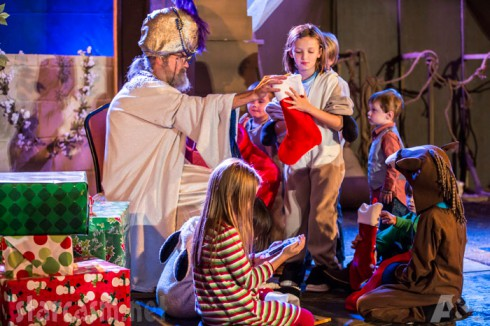Uncle Si passes out stockings to children during the Duck Dynasty Christmas Special