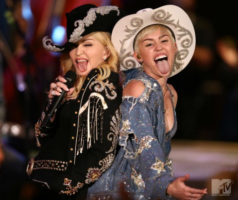 Madonna with Miley Cyrus Unplugged duet on stage