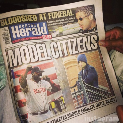 Benzino reading the Boston Herald cover story about his shooting