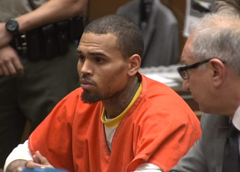 Chris Brown in court wearing an orange jumpsuit