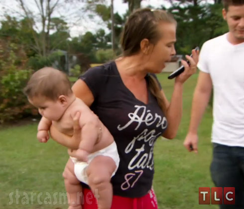 My Big Fat American Gypsy Wedding Season 3 woman holding a baby screaming at her cell phone