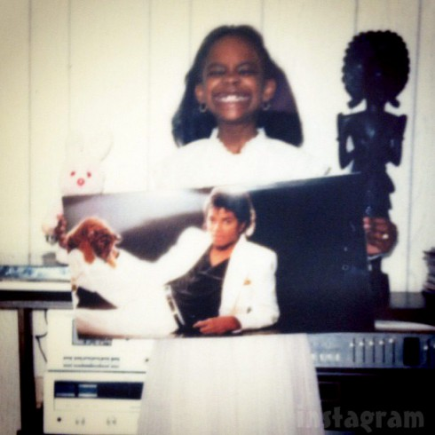 Kandi Burrus throwback photo holding Michael Jackson's Thriller album