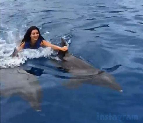 Kim Kardashian swimming with the dolphins