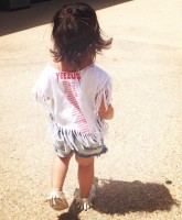 Tracy Nguyen's son Ryan in a Yeezus shirt at North West's 1st birthday party