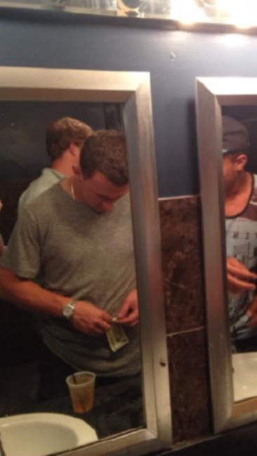 Cleveland Browns backup quarterback Johnny Manziel, seen here doing something potentially incriminating, possibly.