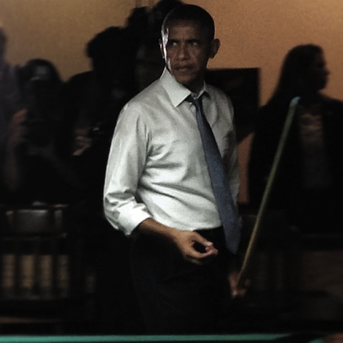 President Obama holding a pool cue, and chalk. Note that the chalk is not a lit blunt. It is chalk, for chalking a pool cue.