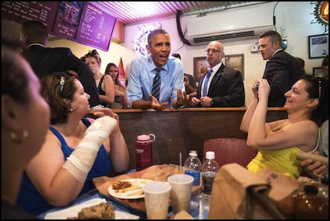 President Obama chatting up customers at Franklin Barbecue in Austin.