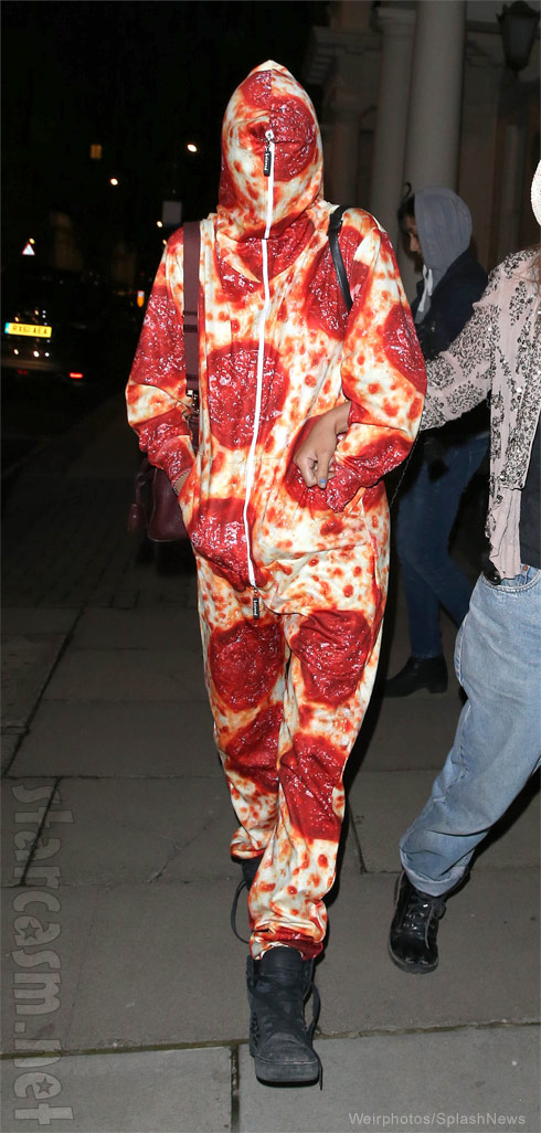 Cara Delevingne wearing a pepperoni pizza onesie