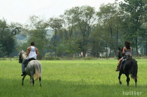 Jenelle Evans riding a horse with Nathan Griffith in Ohio