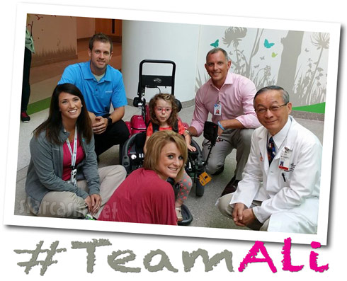Leah Calvert's daughter Ali gets a new wheelchair - Click to enlarge