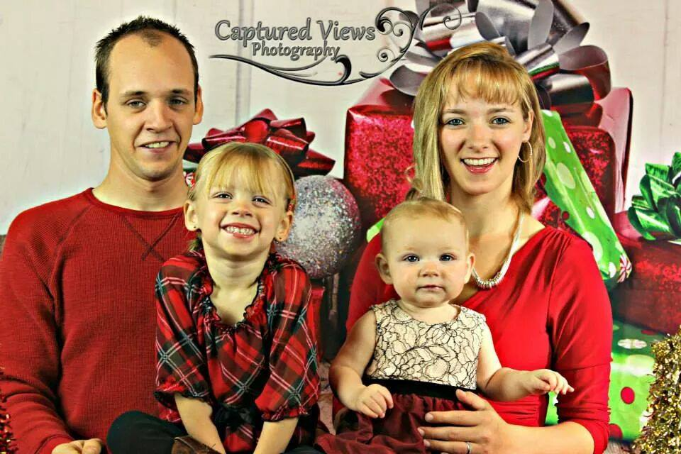 Rebecca and Abe Schmucker with daughters Kayla and Malika Christmas card 2014
