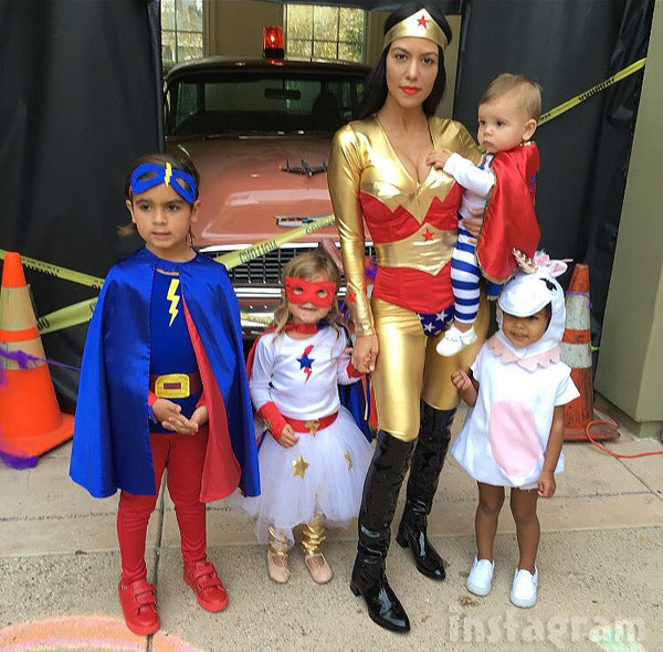 Kourtney Kardashian Wonder Woman costume North West in a unicorn costume