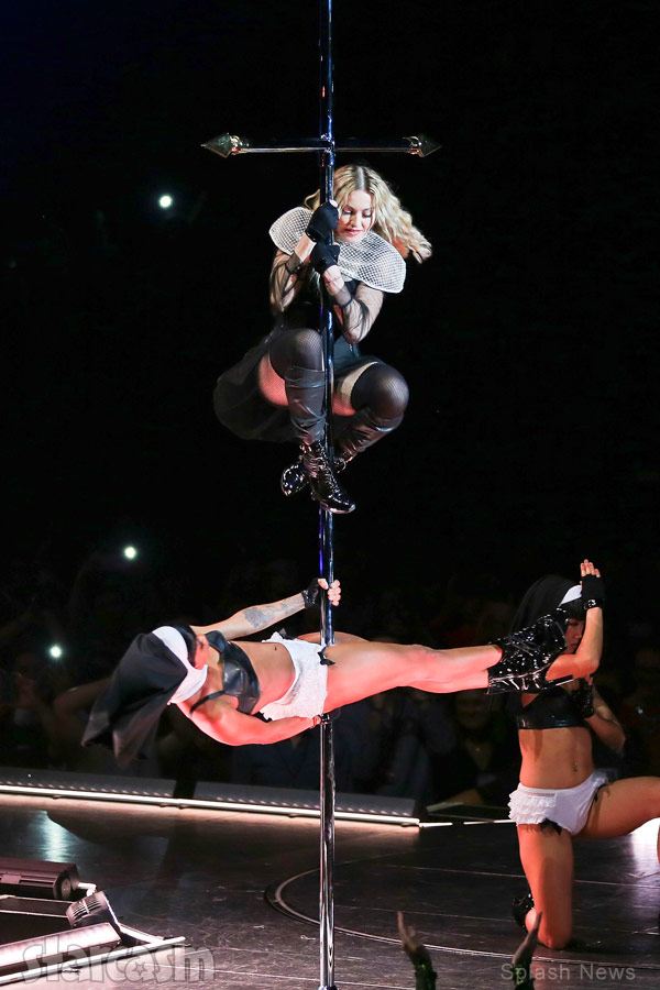 Madonna pole dancing on a cross during a Rebel Heart concert