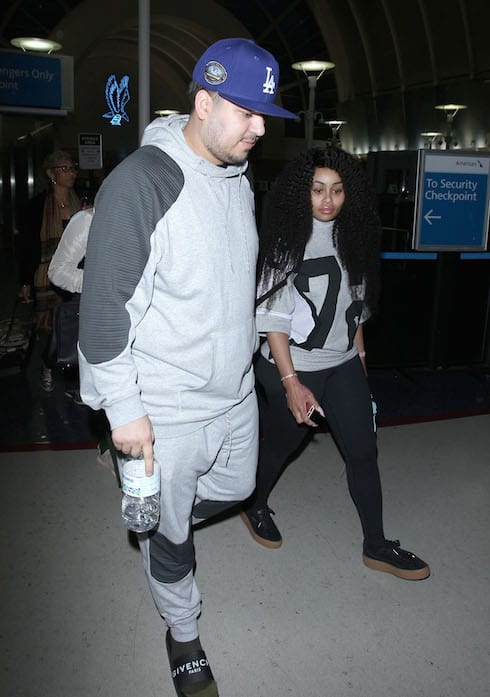 Rob Kardashian and girlfriend Blac Chyna arrive at Los Angeles International Airport (LAX) Featuring: Rob Kardashian, Blac Chyna Where: Los Angeles, California, United States When: 14 Mar 2016 Credit: WENN.com