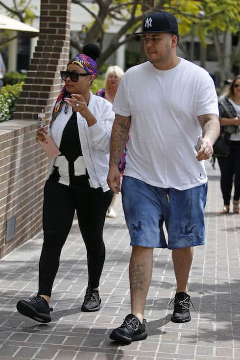 Rob Kardashian and fiance Blac Chyna run errands in Woodland Hills, CA. The happy couple visited 3 different banks in the Woodland Hills, Calabasas area and seemed to enjoy the attention from photographers. Blac was keen to show off the 7carat sparkler on her ring finger and made sure everyone could see it. Pictured: Blac Chyna,Rob Kardashian Ref: SPL1258725 060416 Picture by: TC/Splash News Splash News and Pictures Los Angeles: 310-821-2666 New York: 212-619-2666 London: 870-934-2666 photodesk@splashnews.com