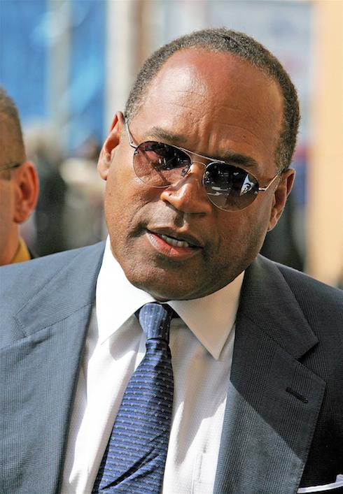 "* O.J. SIMPSON ARRESTED O.J. SIMPSON has been arrested in Las Vegas in connection with a reported armed robbery on Thursday night (13Sep07). Police insiders suggest the former football star-turned-actor faces charges of conspiracy to commit armed robbery, armed robbery and armed robbery with a deadly weapon. The arrest comes as Alfred Bearsdley, the victim of the sports memorabilia raid attempts to clear Simpson's name by claiming the star was ""duped"" into believing a stash of his memorabilia was to be illegally sold. Simpson and five associates raided Beardsley's suite at the Palace Station Hotel & Casino in Las Vegas, pretending to be part of a group interested in buying the memorabilia items, which included the suit the Naked Gun star wore when he was acquitted of the double murder of his wife Nicole and her friend Ron Goldman in 1994. The memorabilia collector/broker claims weapons were brandished at the scene and he and a partner were forced to hand over all the memorabilia they had in the suite at gunpoint. Beardsley initially went on the attack, claiming Simpson ""took control"" of the raid, but now he accepts the fallen actor was duped by another memorabilia collector, Thomas Riccio, who let him and his associates into the suite, where the robbery took place. Beardsley, who has been transferred from the Palace Station to the Hard Rock Hotel, where he's staying as a guest of entertainer Jeff Beacher, says, ""O.J. didn't do anything wrong. He was actually kind of duped. ""Thomas Riccio told him that we were gonna have thousands of photographs there, personal family photographs of the Simpson family, and it was never intended to be there. ""They (Simpson and associates) couldn't find the room.... They call Riccio on his cellphone and Riccio told them, `Stay put, I'll come and get you.' He walked them all through the front door."" Beardsley reveals he and Simpson have spoken about the ""misunderstanding"" and he claims the star has apologised for his actions. At a press conference on Friday (14Sep07), Las Vegas police confirmed Simpson was helping them with their investigation into the robbery. Another man, Walter Alexander, a longtime friend of Simpson, has also been arrested for conspiracy to commit armed robbery in connection with the alleged raid. He was released on bail early on Sunday (16Sep07). Police have also confirmed they have seized two guns they believe were used in the alleged robbery. Under Nevada law, Simpson faces as much as 30 years in jail if he's found guilty of armed robbery. He maintains he did nothing wrong, and was simply reclaiming sports memorabilia that belonged to him. (KL/WN&WNV) O.J. Simpson arriving at lawyer Johnnie L Cochran's funeral at West Angeles Cathedral Los Angeles, California- 06.04.05 Featuring: * O.J. SIMPSON ARRESTED Where: Los Angeles, California, United States When: 06 Apr 2005 Credit: WENN"