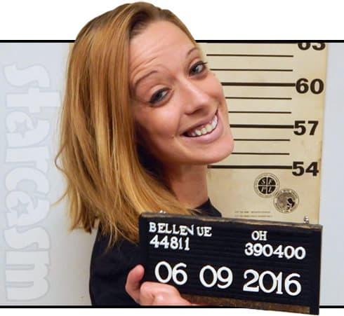 Smiling mug shot lady after McDonald's arrest