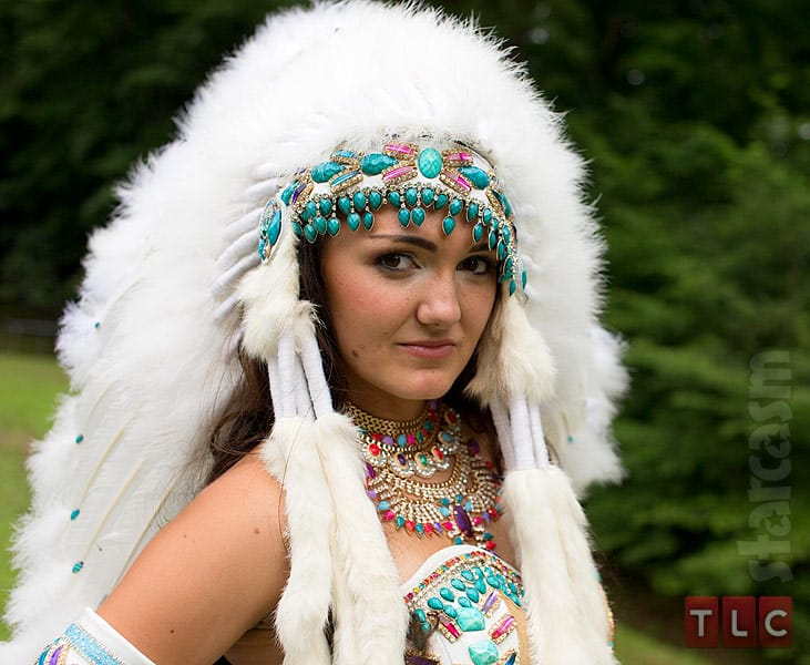 native american girl with gun