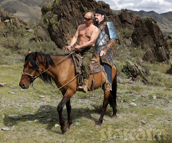 Vladimir Putin and Steven Seagal riding a horse