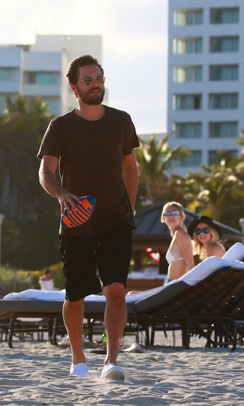 Scott Disick plays football on the beach ahead of Superbowl Sunday