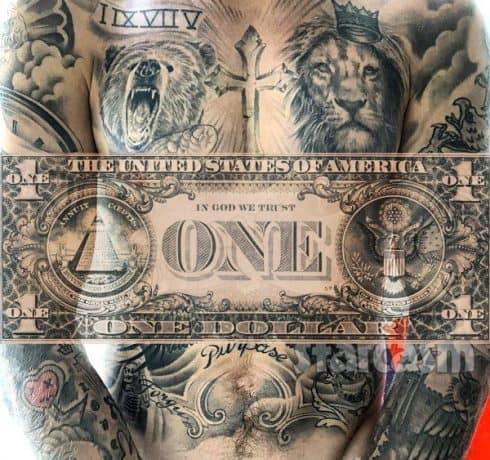 Justin Bieber tattoos chest dollar bill
