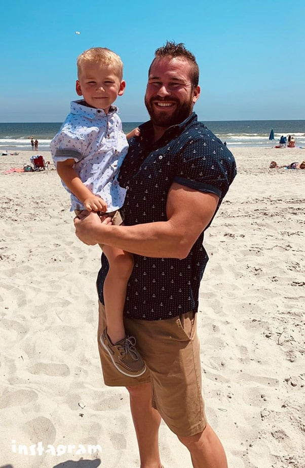 Nathan Griffith and Kaiser together at the beach
