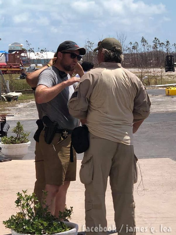 John David Duggar carrying a badge and gun in the Bahamas as part of the MEDIC Corps Hurricane Dorian relief efforts